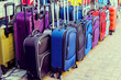Cheap luggage in the street shop. Multicolored travel suitcases. toning