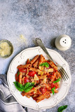 Wholewheat penne pasta with bolognese sauce.Top view with copy space.