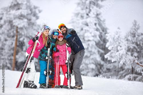 Leinwanddruck Bild Man on skiing showing something with finger