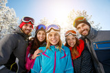 smiling friends on winter vacation - 231254177