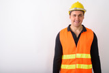 Portrait of young man construction worker standing - 231260163