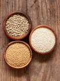 Organic lentils, couscous and sesame seeds in wooden bowls. - 231265728