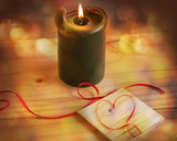 Romantic background with the burning candle and heart on message board - 231270752