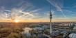 canvas print picture - Der Olympiapark in München als Luftaufnahme einer Drohne zum Sonnenuntergang im Herzen von München