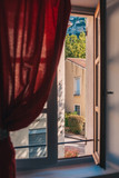 View through the open window onto the streets in Fontaine-de-Vaucluse