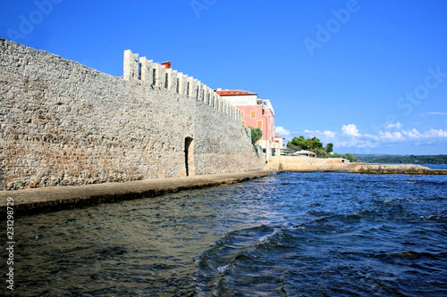 Leinwanddruck Bild old wall in Novigrad Cittanova, Istria, Croatia