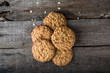 Homemade oatmeal cookies on wooden board on old table background. Healthy Food Snack Concept. Copy space. Milk and cookies. Still life of food. Christmas cookies. Healthy food. Breakfast concept.