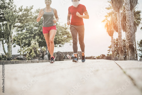 Sticker Couple of happy fitness friends running outdoor