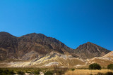 Volcanic hills on a hot summers day on a Greek Island - 231326124