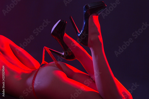 obraz PCV Girl in sexy lingerie .Luxury ass. Slender legs. Athletic body. Temptation. Silicone implants. Women's butt in red panties close-up .Hot girl. BDSM.
