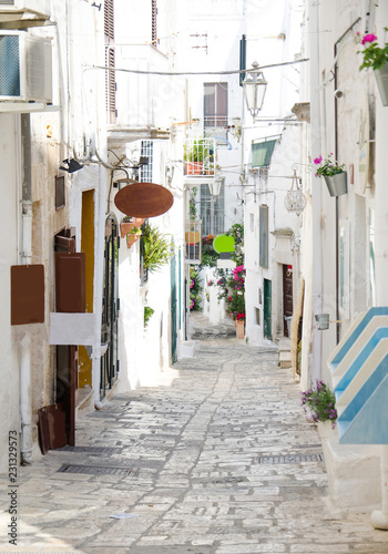 Narrow streets of Ostuni town with white buildings, Puglia, Italy
