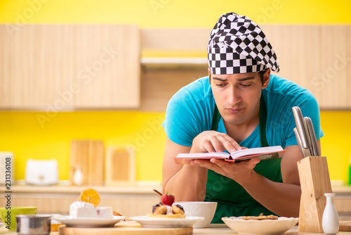 Wall mural Man cook preparing cake in kitchen at home