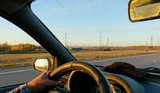 Long trip by car. The view from the cabin on the steering wheel and the landscape outside the window - 231352195