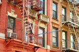 Close-up view of New York City apartment buildings with emergency stairs in Little Italy neighborhood of Manhattan NYC - 231378163