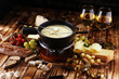 Leinwanddruck Bild - Gourmet Swiss fondue dinner on a winter evening with assorted cheese