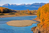 Beautiful Landscape in prime autumn colors with blue river water running through Forest and rugged Mountain Peaks, Kispiox Valley, BC, Canada - 231402546