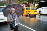 Mature senior white haired woman waiting for taxi cab in New York - 231408543