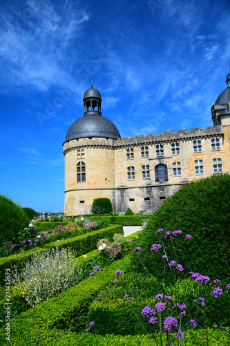 The gardens and outer walls of the magnificent Chateau de Hautefort in Aquitaine, France
