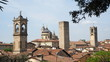 Leinwanddruck Bild - Bergamo, Italy. The old town. Landscape at the city center, the old towers and the clock towers from the ancient fortress