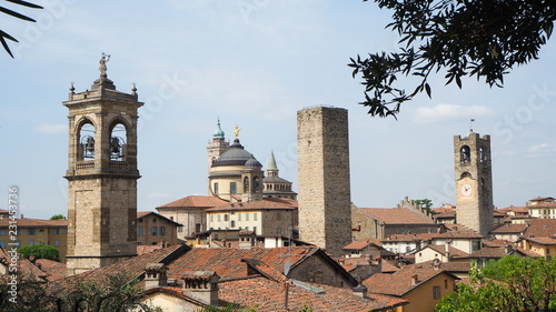 Leinwanddruck Bild Bergamo, Italy. The old town. Landscape at the city center, the old towers and the clock towers from the ancient fortress