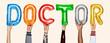 Leinwanddruck Bild - Hands showing doctor balloons word