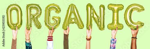 Leinwanddruck Bild Hands showing organic balloons word