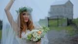 Romantic bride under a veil on the background of a small church. Georgia. Kazbegi - 231457115