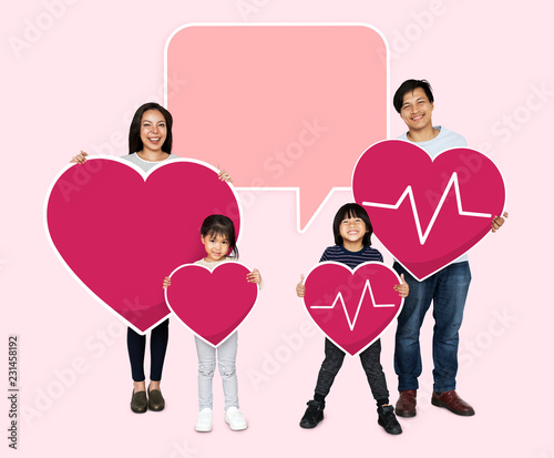 Leinwanddruck Bild Happy family holding a pink heart icons