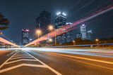 the light trails on the modern building background. - 231460159