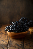 Fresh ripe grapes in the wooden bowl