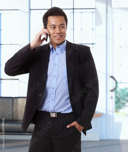 Wall mural Asian businessman on the phone