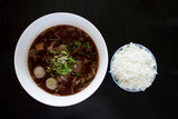 Delicious beef noodle meat ball and rice on wood floor. - 231490559