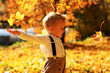 Leinwanddruck Bild - Little cute boy walking in autumn Park