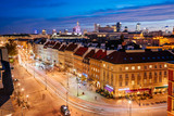 The Krakowskie Przedmiescie street in the Old Town of Warsaw. it is one of the central historic streets of Warsaw seen from above at night.
