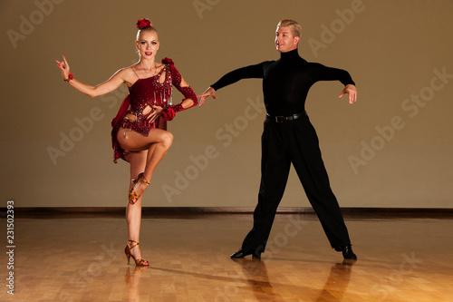latino dance couple in action  preforming a exhibition dance - wild samba - 231502393
