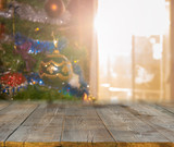 christmas table background with christmas tree out of focus - 231511320