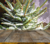 christmas table background with christmas tree out of focus - 231511376