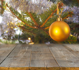 christmas table background with christmas tree out of focus - 231511502