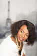 Young African-American Woman in front of Eiffel Tower in the Winter