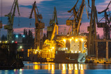 industrial areas, shipyard and port after sunset - Szczecin, Poland - 231515138
