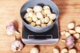 peeled garlic in a bowl close-up - 231515156