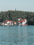 View of a yacht to the small island of Paleo Trikeri in the Pagasetic Gulf - 231517502