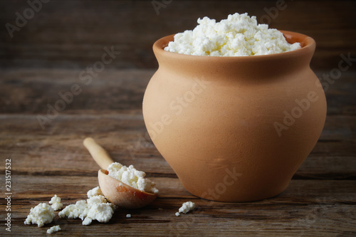 Leinwanddruck Bild Cottage cheese in rustic vintage clay pot.