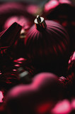 Close up of dark red christmas decoration ornaments, balls, baubles, stars, swirls and heart shaped with golden details and bokeh blur in background for festive holiday or seasons greetings card - 231521172