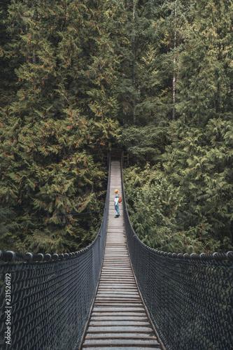 Girl on a suspension bridge
