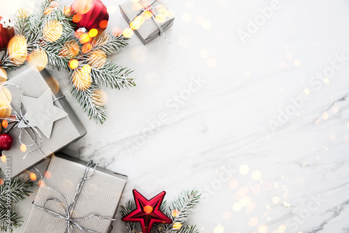 Christmas and New Year holiday background. Xmas greeting card. Christmas gifts on white marble background top view. Flat lay © elenabdesign