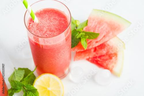 Leinwandbild Motiv Watermelon smoothie with lemon and mint