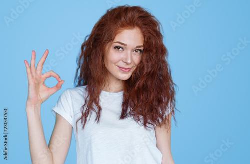 Smiling woman gesturing OK