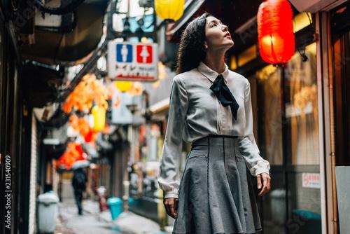 Happy japanese girl walking in Shinjuku, tokyo