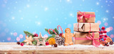 Christmas Decoration - Gift And Gingerbread With Ornament On Table - 231541154
